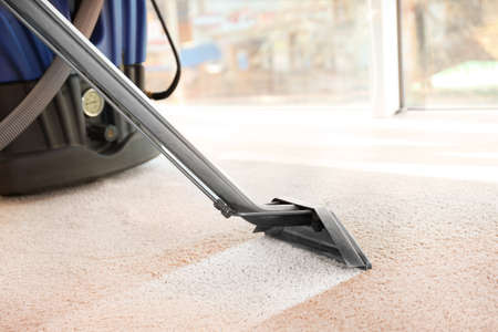 Foto für Cleaning service concept. Steam vapor cleaner removing dirt from carpet in flat, closeup - Lizenzfreies Bild