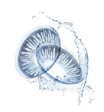 Foto de Eyesight correction concept. Contact lenses and water splashes on white background - Imagen libre de derechos