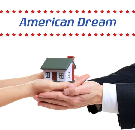 Photo pour Text AMERICAN DREAM and people holding house model on white background - image libre de droit