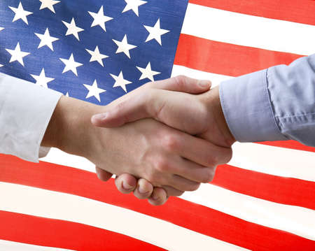 Photo for Men shaking hands and American flag on background. Support concept - Royalty Free Image