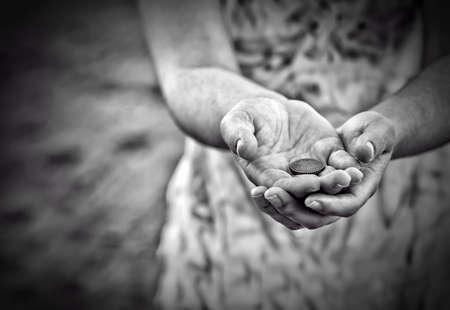 Foto de Poverty concept. Poor woman begging for money, closeup - Imagen libre de derechos