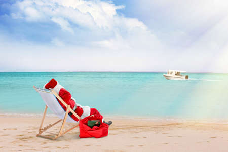 Photo for Santa Claus relaxing on sea shore. Christmas and New Year vacation - Royalty Free Image