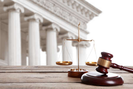 Photo for Judge's gavel with scales and courthouse on background. Concept of law - Royalty Free Image
