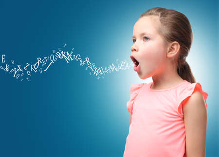 Foto de Little girl and letters on color background. Speech therapy concept - Imagen libre de derechos