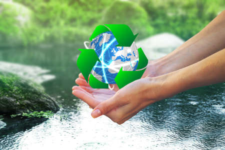 Photo pour Woman holding globe and sign of recycling over water, closeup. Ecology and environment conservation - image libre de droit