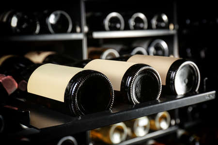 Foto de Bottles of wine on shelf at store, closeup - Imagen libre de derechos