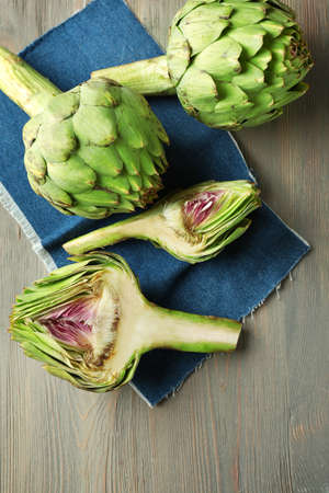Photo for Artichokes on wooden background - Royalty Free Image