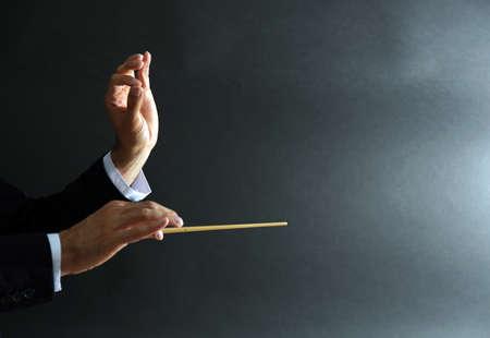 Foto de Music conductor hands with baton on black background - Imagen libre de derechos