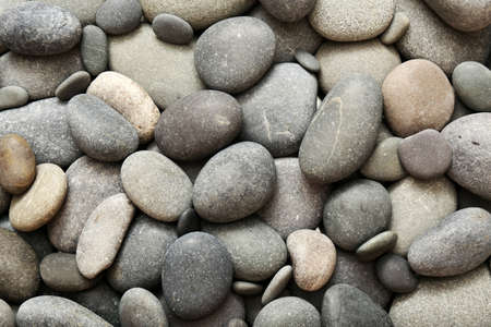 Photo pour Gray sea pebbles background - image libre de droit