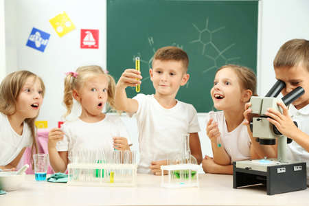 Foto de Cute pupils doing biochemistry research in chemistry class - Imagen libre de derechos