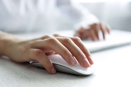 Photo for Female hand with computer mouse on table, closeup - Royalty Free Image