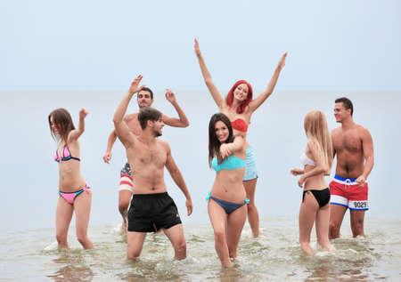 Photo for Beautiful young people having fun on beach - Royalty Free Image