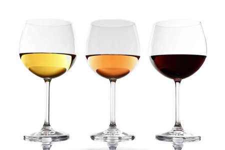 Foto de Glasses with white, rose and red wine isolated on white background - Imagen libre de derechos
