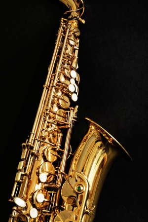 Foto de Beautiful golden saxophone on black background, close up - Imagen libre de derechos