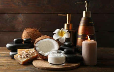 Photo for Spa coconut products on dark wooden background - Royalty Free Image