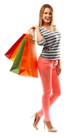 Photo pour Young pretty woman with shopping packages isolated on white - image libre de droit