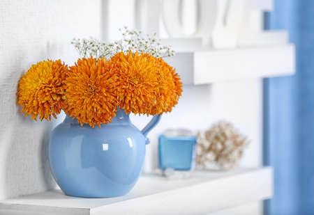 Photo pour Blue home decor on the shelf - image libre de droit