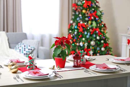 Foto de Christmas table setting on light room background - Imagen libre de derechos