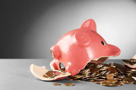 Foto de Broken piggy bank on the table against grey background, close up - Imagen libre de derechos
