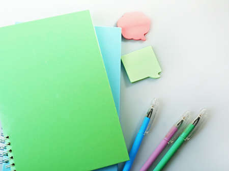 Photo for A pile of notebooks and stationary, isolated on white background - Royalty Free Image