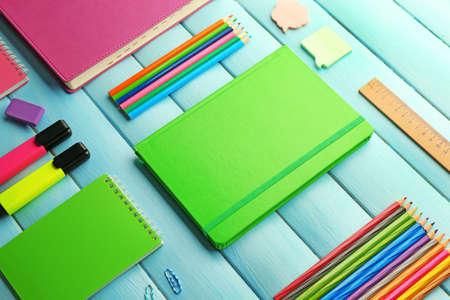 Photo pour School set with notebooks and colored pencils on wooden blue background - image libre de droit