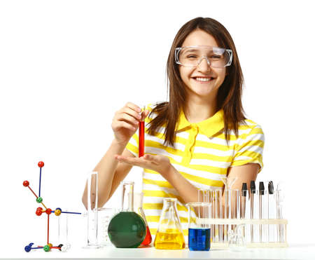 Foto de Beautiful girl with chemical flasks and test-tubes isolated on white - Imagen libre de derechos