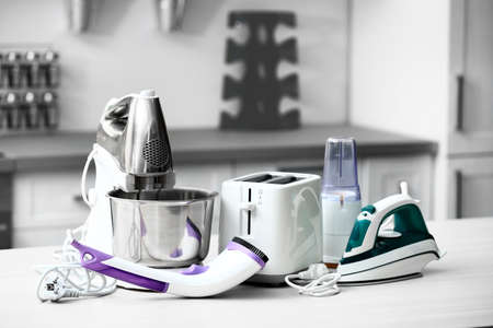Foto de Household and kitchen appliances on the table in kitchen - Imagen libre de derechos