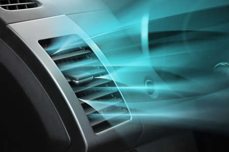 Photo pour Switched on conditioner with flow of cold air in car - image libre de droit