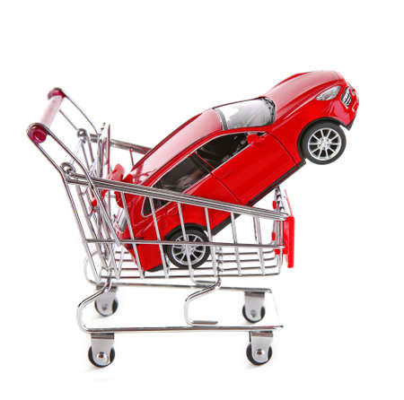 Photo for Red car in shopping trolley, isolated on white - Royalty Free Image