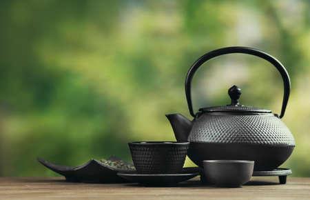 Foto de Black pialats and teapot on blurred background - Imagen libre de derechos