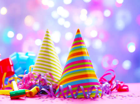 Photo for Party hats and other stuff on blurred garland background - Royalty Free Image