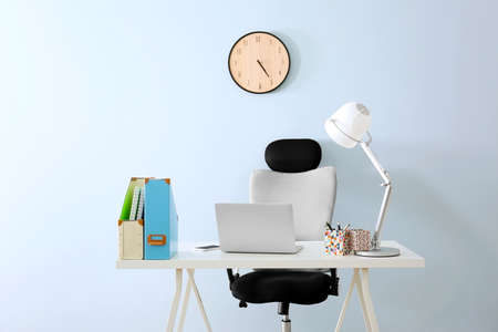 Photo for Modern workplace with office chair and laptop - Royalty Free Image