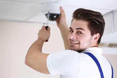 Photo pour Professional CCTV technician working. - image libre de droit