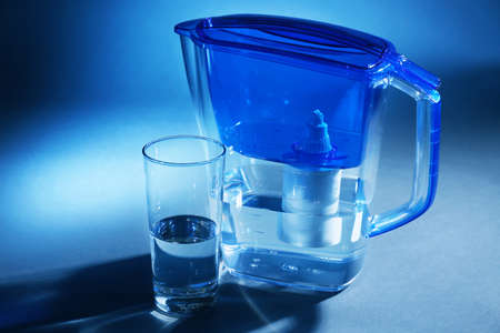 Photo for Filter and glass of water on dark blue background - Royalty Free Image