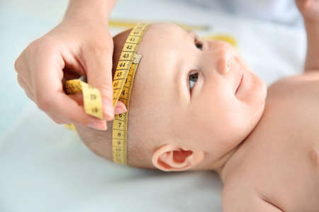 Photo for Professional pediatrician examining smiling baby - Royalty Free Image