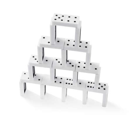 Photo pour Tower of dominoes, isolated on white - image libre de droit