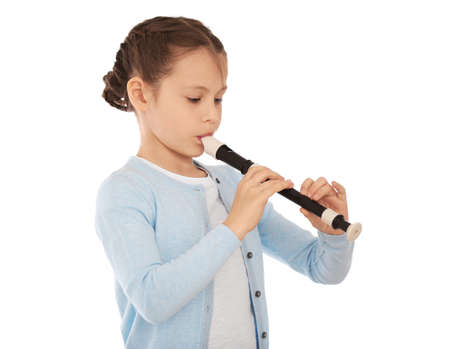 Photo for Little girl playing flute on light background - Royalty Free Image
