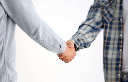 Photo for Men shaking hands on light background - Royalty Free Image