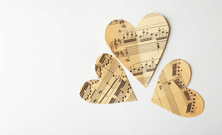 Photo for Paper hearts with notes on white background, music concept - Royalty Free Image