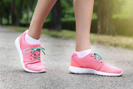 Foto für Woman wearing pink sneakers - Lizenzfreies Bild
