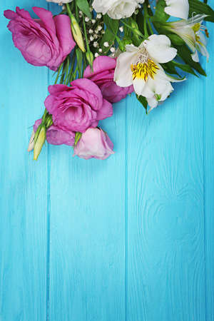 Photo for Fresh flowers on turquoise  wooden background - Royalty Free Image