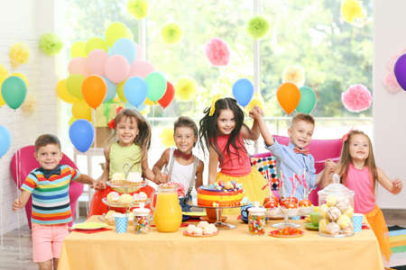 Photo for Children's funny birthday party in decorated room - Royalty Free Image