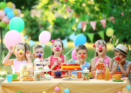 Photo for Children celebrating birthday in park - Royalty Free Image