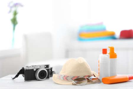 Photo pour Summer beach set on table in room - image libre de droit