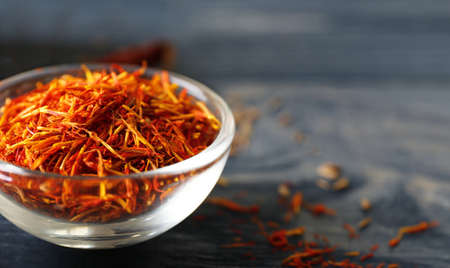 Photo for Saffron in glass bowl, closeup - Royalty Free Image