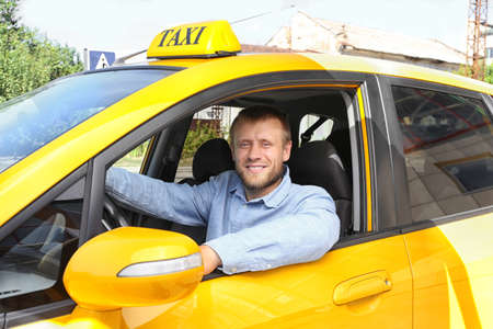 Foto per Handsome taxi driver sitting in car - Immagine Royalty Free