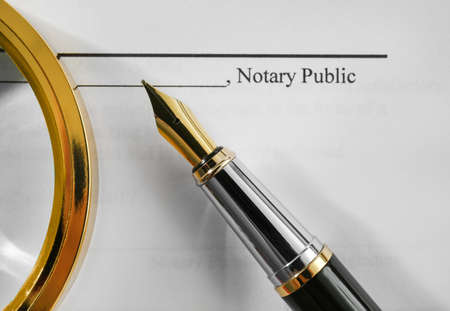Photo pour Notary public document, magnifier and fountain pen, close up view - image libre de droit