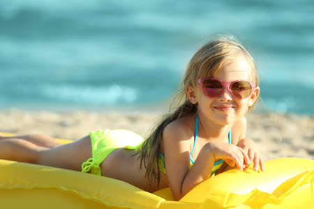 Photo for Cute girl on inflatable mattress - Royalty Free Image