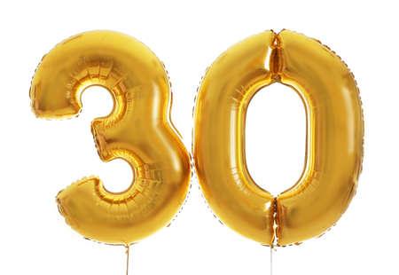 Photo pour Golden birthday balloons on light background - image libre de droit