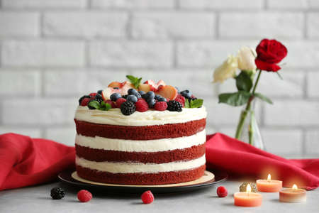 Photo for Delicious cake with fruit and berries decoration on gray table - Royalty Free Image